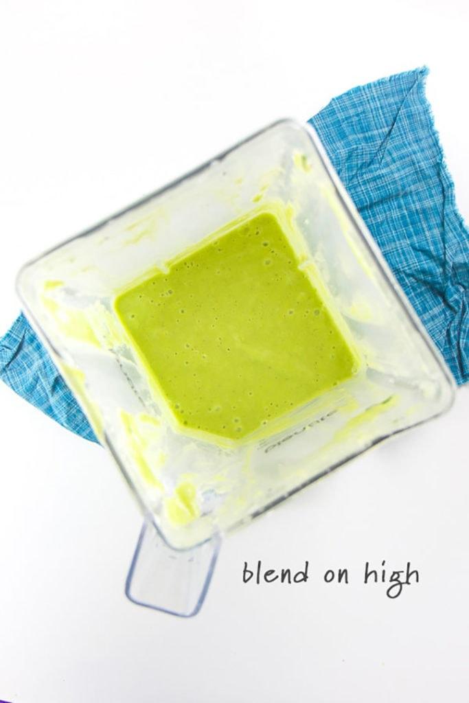 blender full of green smoothie for baby