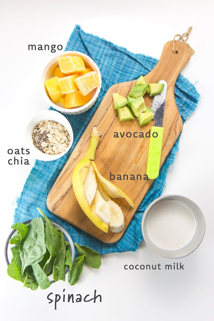 smoothie ingredients spread out on a cutting board
