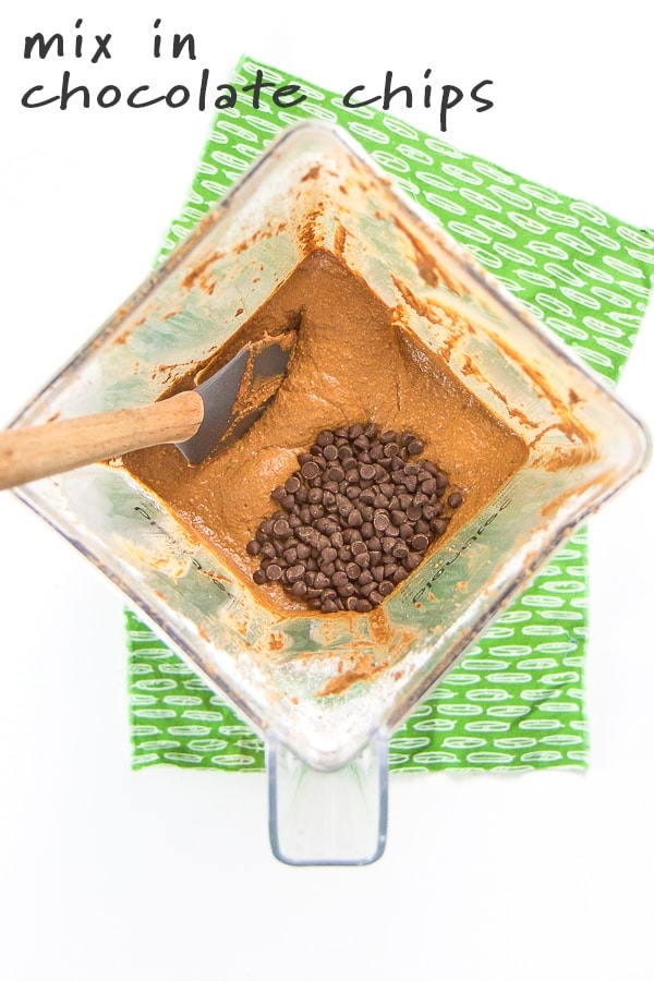 blender with batter and chocolate chips for pumpkin chocolate muffins