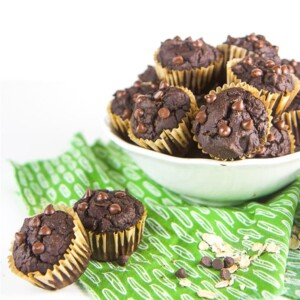 Allergy friendly pumpkin chocolate muffins for kids and toddlers in a white bowl with two muffins on the side.