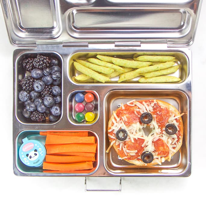 silver planetbox filled with bagel pizza, carrots, berries, dye-free candy.