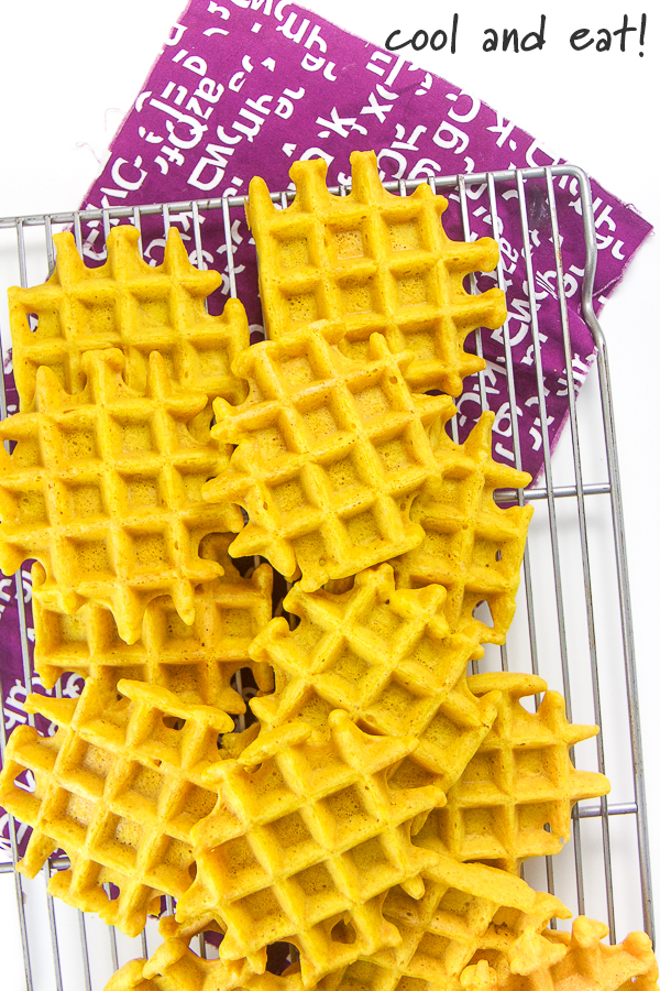 Golden milk waffles on a cooling rack.