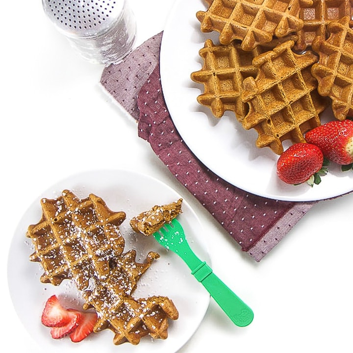 gingerbread waffles on a plate with a small one for a toddler