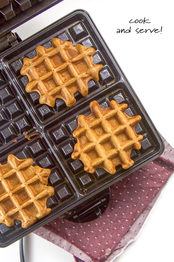 Healthy gingerbread waffles in a waffle maker.