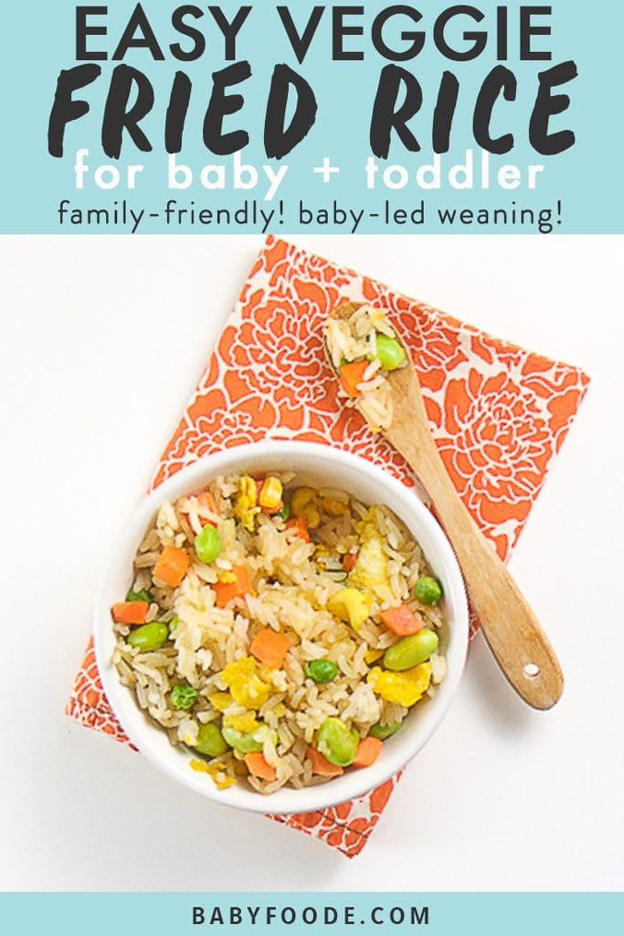 graphic text - easy veggie fried rice for baby + toddler - family friendly! baby-led weaning! graphic image of a small white bowl filled with the veggie fried rice on top of an orange napkin. There is a small wooden spoon on top of the napkin with rice in it.