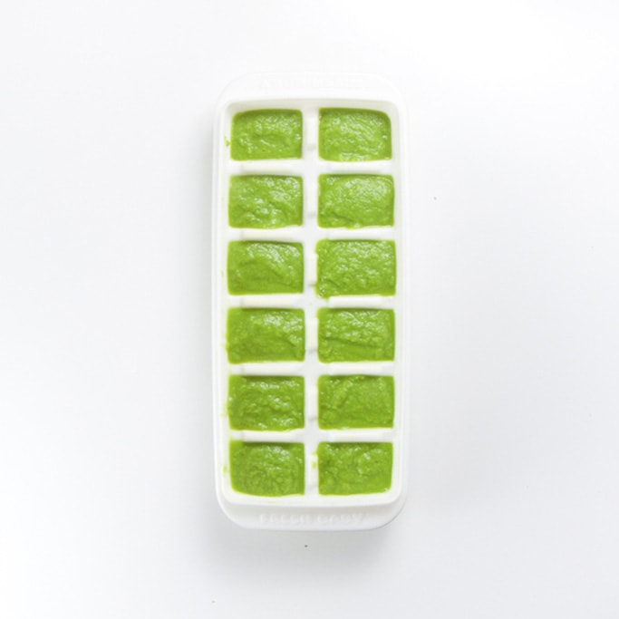 white freezer tray sitting on a white background filled with a creamy green organic green bean baby food recipe