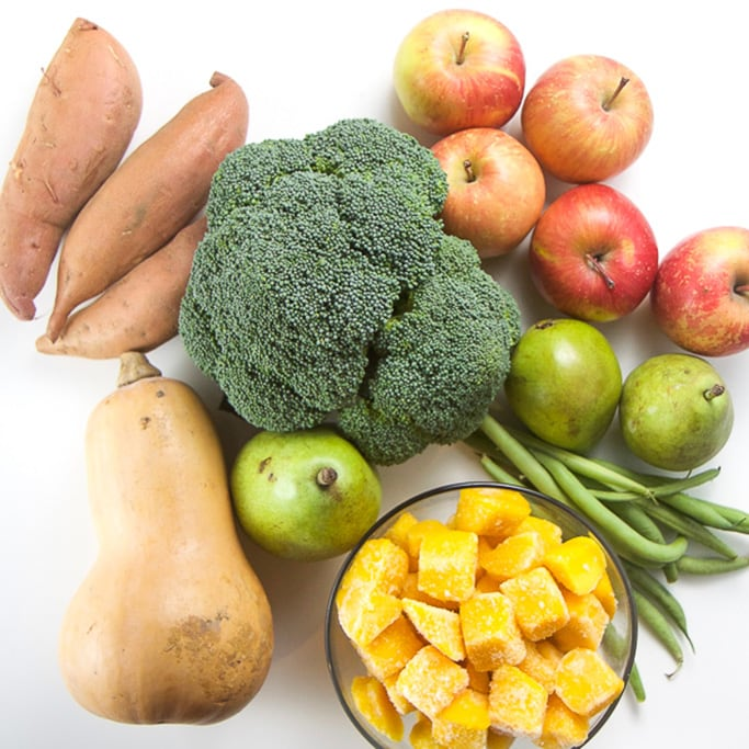 group of produce for the 7 organic baby food recipes in this post- sweet potato, broccoli, apples, pears, green beans, butternut squash and frozen mangos.