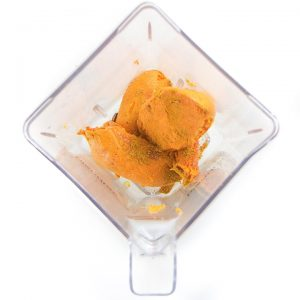 Pureed sweet potatoes for baby in a blender.
