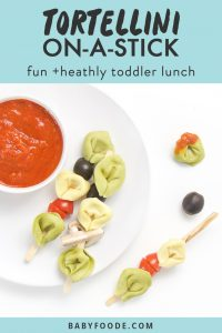graphic for post- text reads tortellini on-a-stick, fun and healthy toddler lunch. image is of small white plate sitting on a white surface. On top of plate is a small white bowl filled with a dipping sauce and 3 wooden sticks filled with tortellini and veggies, a couple of tortellini and veggies are scattered on the table.