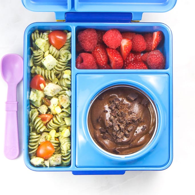 Blue school lunch box filled with easy and colorful school lunch ideas for kids.