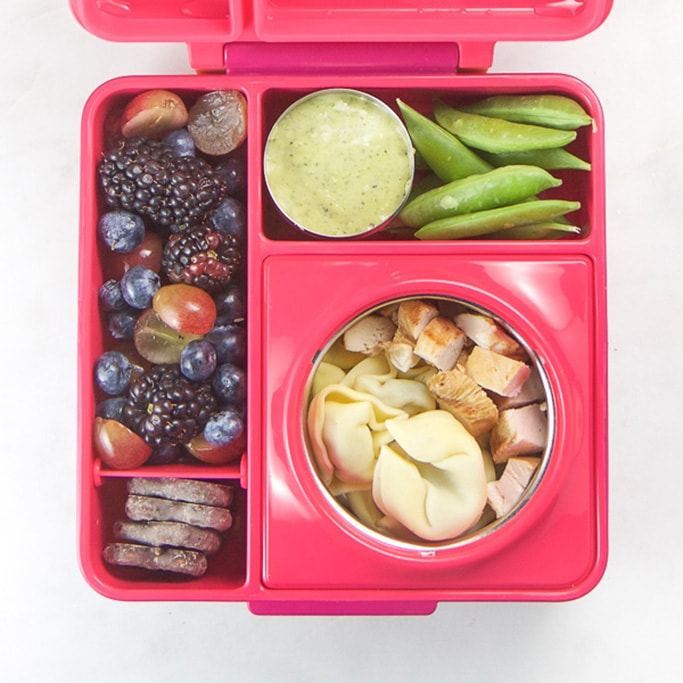 Pink school lunch box filled with healthy and colorful school lunch ideas for kids.