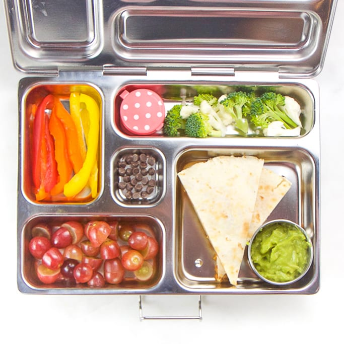 school lunch box silver planet box filled with allergy-free quesadilla, guacamole, broccoli, peppers, grapes and chocolate chips.