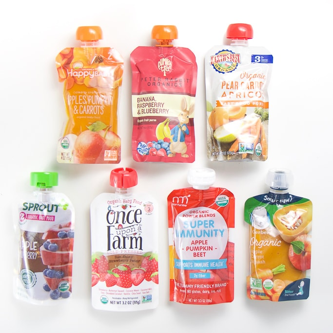 7 organic baby food pouches lined up for taste testing.