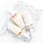 A white plate with 3 healthy funfetti popsicles on top.