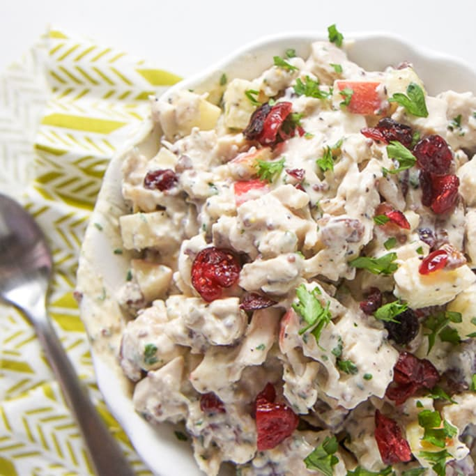 A white bowl filled with harvest chicken salad.