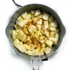 Saucepan with chopped pears and spices getting ready to book for a homemade baby food puree.