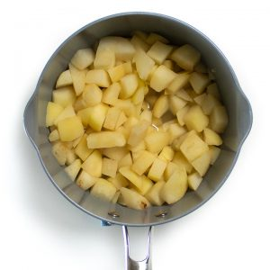 Cooked pears in a saucepan.