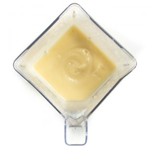 Blender full of homemade baby food pureed to a smooth texture.