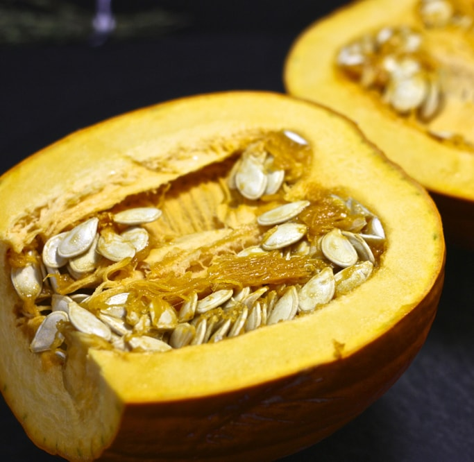 pumpkin on it's side with the seeds still inside