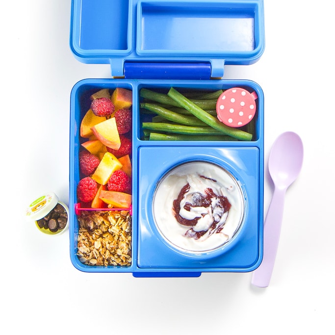 A blue bento box filled with a healthy school lunch.