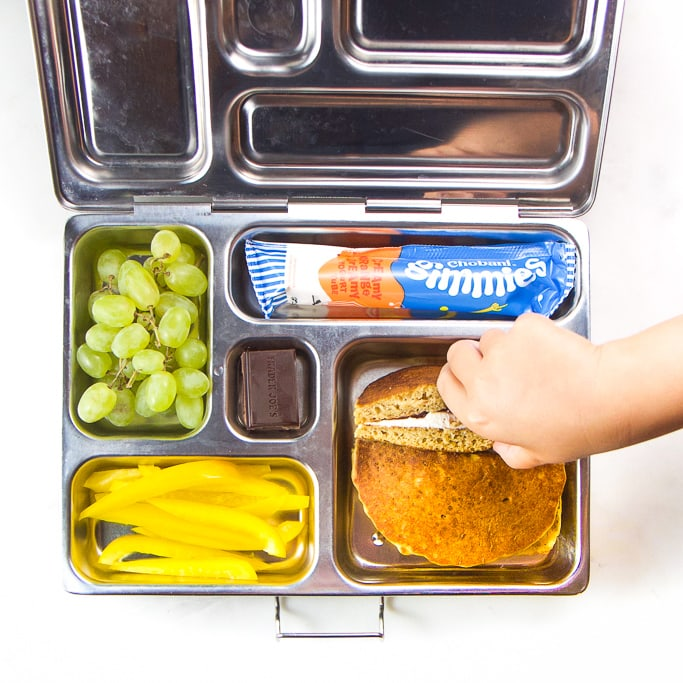 A silver bento box filled with one of 100 healthy school lunch box ideas.