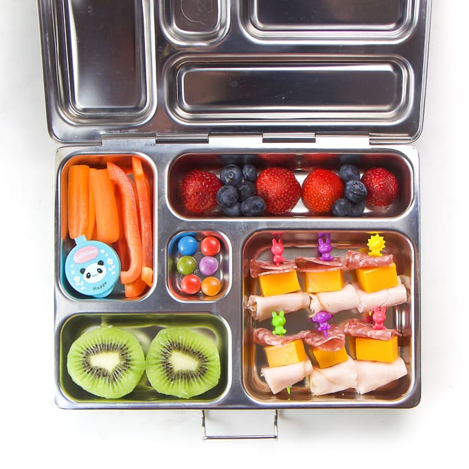 A silver bento box filled with a healthy school lunch box.