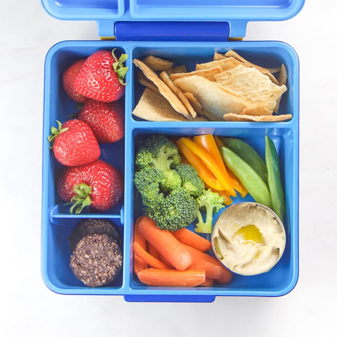 A blue bento box filled with healthy school lunch box ideas
