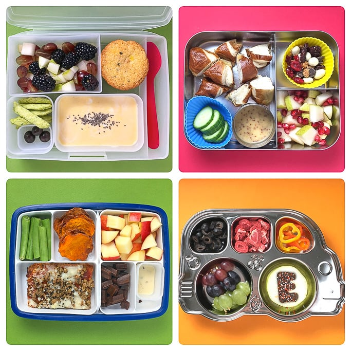 Four different bento boxes filled with healthy can colorful school lunches.