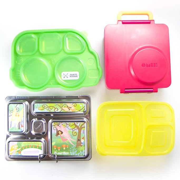 4 bento boxes for kids spread out on a white background.