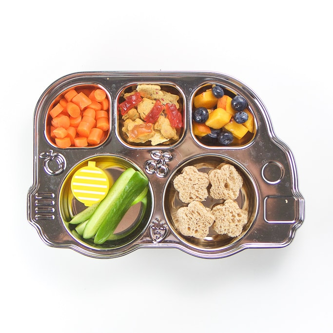 Innobaby Bus Bento filled with a school lunch.