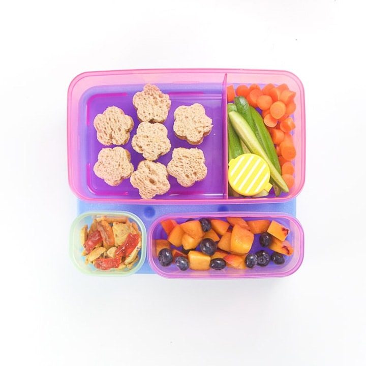 Colorful contaniers for a kids back to school lunch packed.