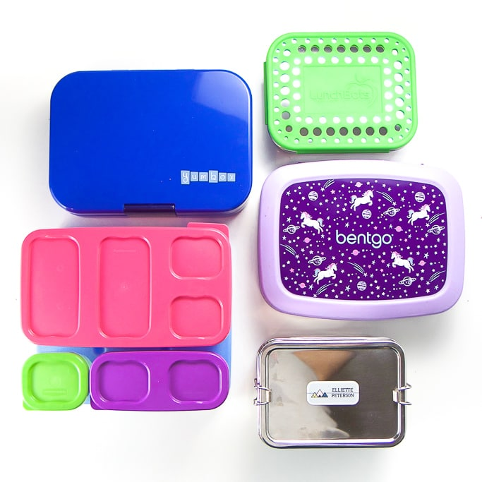 5 different bento boxes for kids spread out on white background.