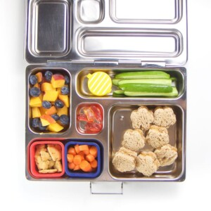 Stainless steel bento box for kids filled with healthy school lunch.