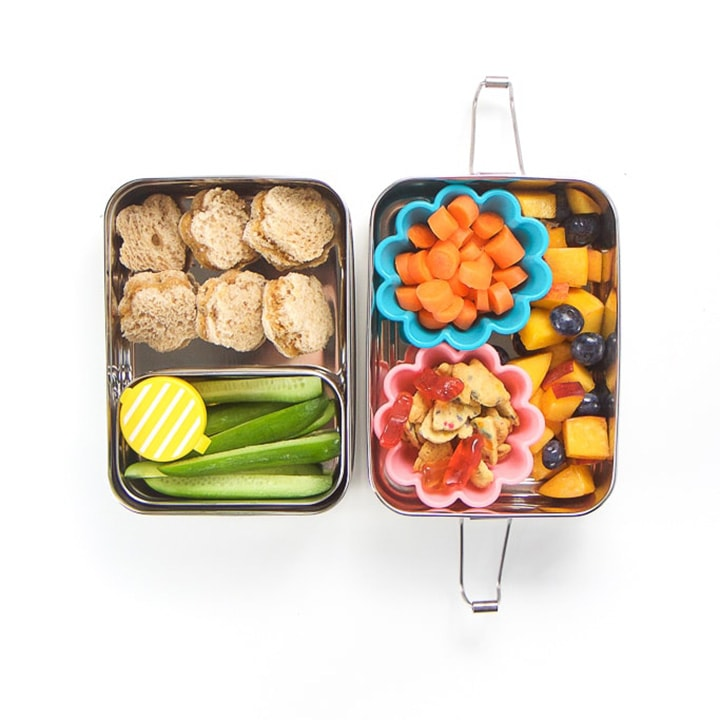 Silver school lunch box for kids - full of a healthy lunch.