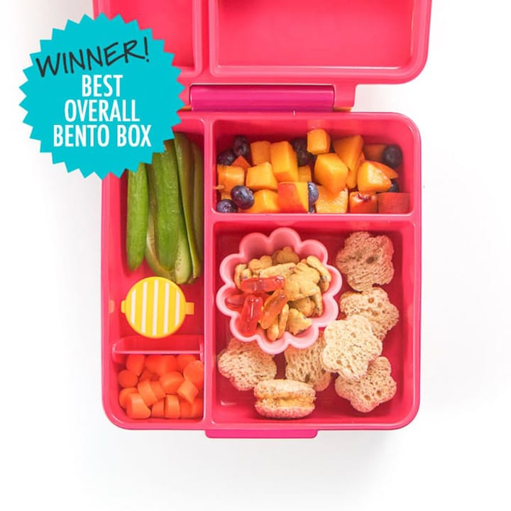 Pink school lunch box full of healthy food for kids. This box won for the best overall bento box.