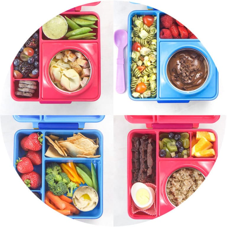 A grid of blue and pink lunch boxes filled with health school lunches.