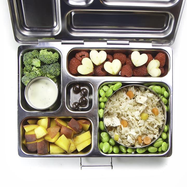 A kid friendly school lunch inside a bento box.