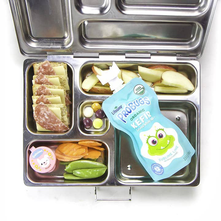 A bento box filled with good for your foods for kids.
