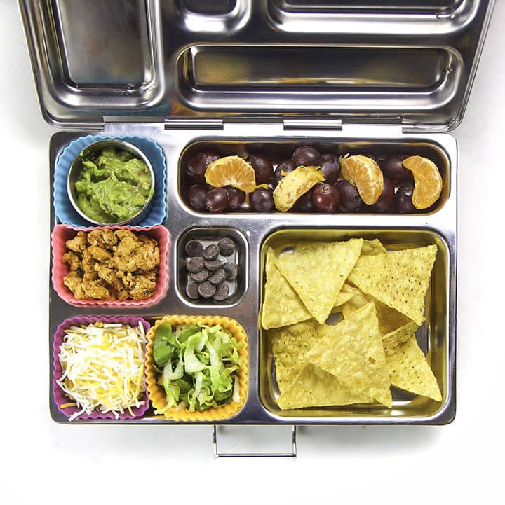 A healthy packed bento box that is full of food.