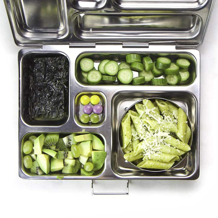 A fun lunch box for school for kids filled with all green foods.