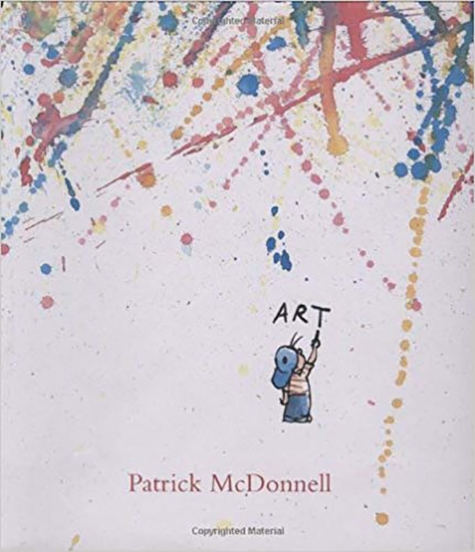 A book cover called Art, with splatters of paint on it.