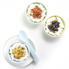 3 bowls filled with cottage cheese and topped with chunks of fruit.
