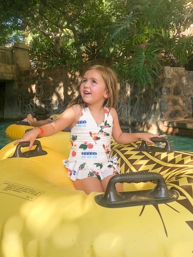 Girl sitting on a raft at Disney Aulani.