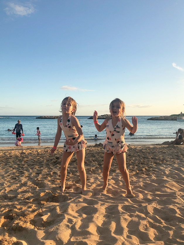2 girls on sandy beach - 6 best of Disney Aulani Resort.