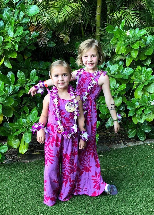 2 girls getting ready for the luau