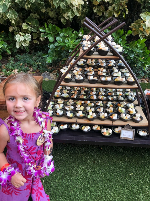 girl standing in front of a kids dessert tour before la'ua starts - best of Disney Aulani Resort.