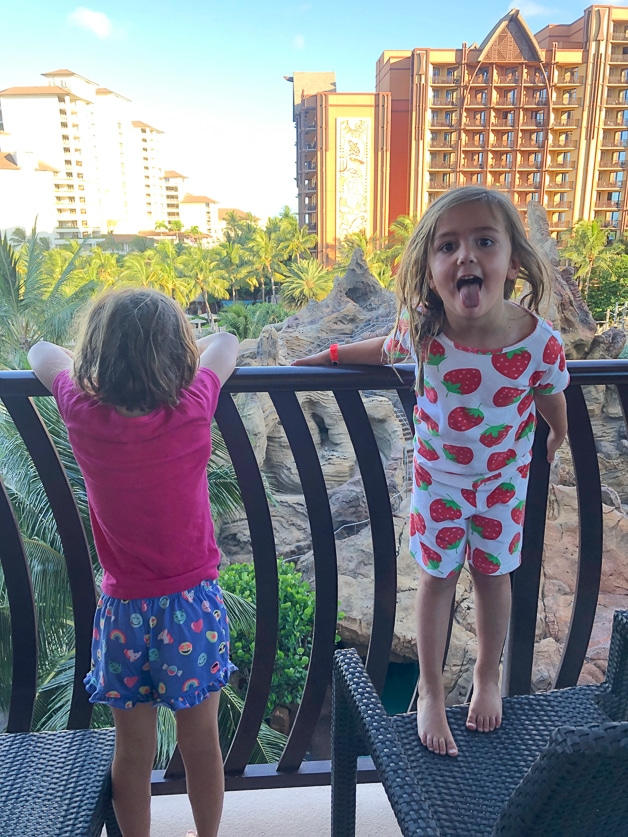 Girls on the balcony at Disney Aulani with bedhead.
