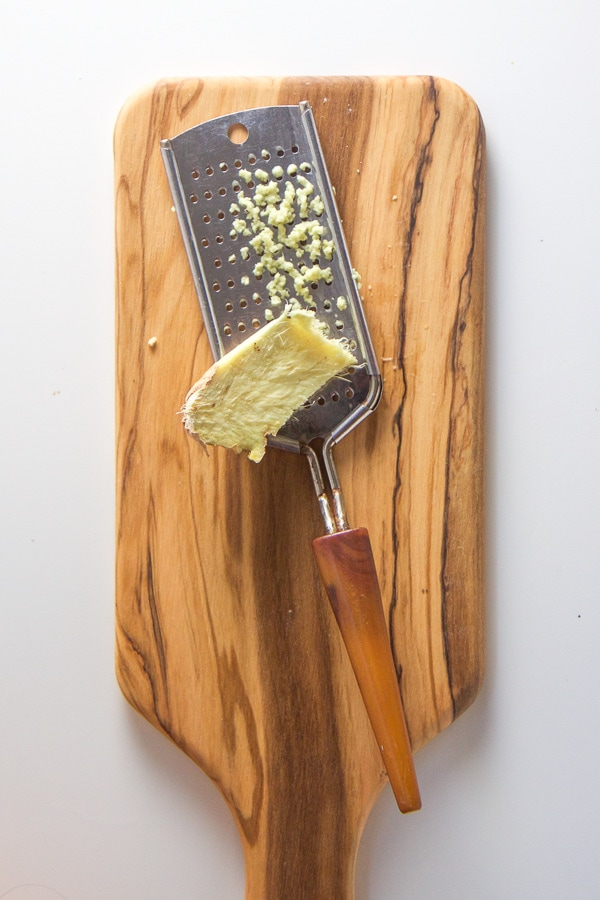 grated ginger on a cutting board.