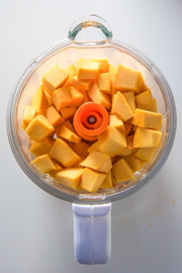 chopped pumpkin inside a baby food machine.