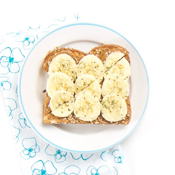 almond toast with bananas and hemp sprinkles for baby and toddler.
